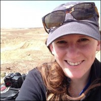 Holly with cap and sunglasses in the desert