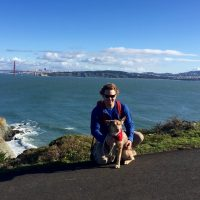 Al with dog, Golden Gate Bridge and San Francisco Bay in the background